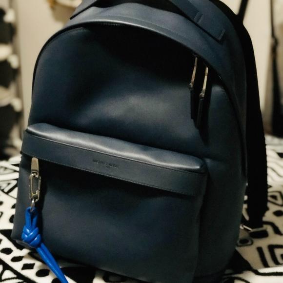 8f96e18c715f Michael Kors Odin Leather Backpack + keychain. M_5ba8607204e33dbdaa53df29